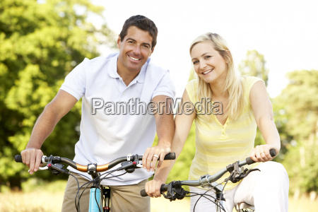 couple riding bikes in countryside